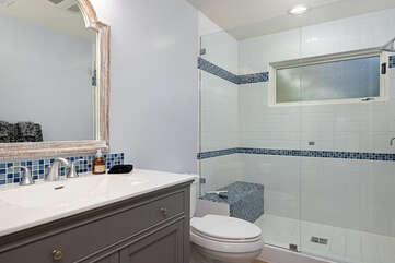 There is a shared bathroom upstairs for the two bedrooms with a tiled shower.