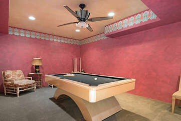 Here you will find a pool room in the basement with ample seating.