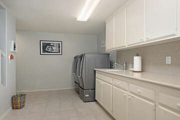 There is a Full size washer and dryer in the basement downstairs.