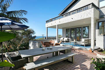 Enjoy a nice meal with surrounding ocean views on this large 8+ outdoor table