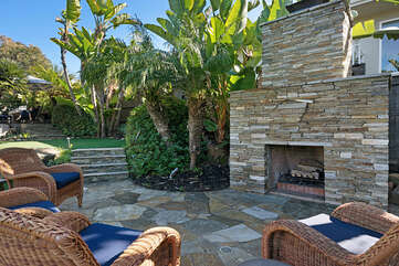 Outdoor wood burning fireplace down by the putting greens and hot tub.