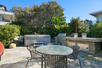 Outdoor kitchen with a gas BBQ, hot tub and plenty of sitting for the whole family.