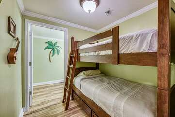 Bunkbeds and door leading into shared bathroom