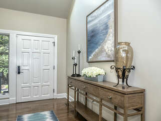 Attractive foyer with a table to rest your keys.