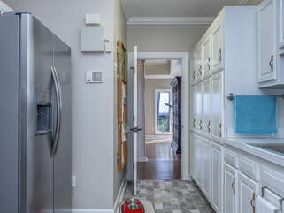Oversized laundry room with additional refrigerator