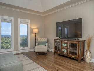 Master bedroom features a large HDTV and views of the ocean.