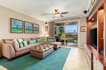Living Room with Sectional Sofa, 3 Wall Paintings, and Views of the Golf Course