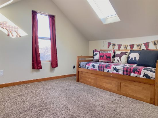 Open concept twin bed with twin trundle and skylight above