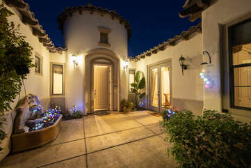 Located in the front courtyard is a beautiful entry way and a koi pond.