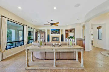 Lounge in front of a 60-inch Samsung Smart television and natural gas Fireplace.