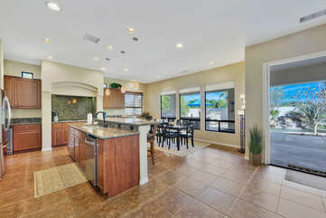 The open floor plan allows for a nice flow between the family room, kitchen and dinning area.