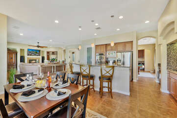 The fully-equipped kitchen features stunning stainless steel appliances