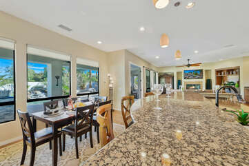 The casual dining area features a dining table with seating for six.