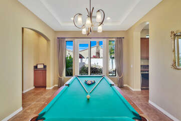 Challenge your family to a friendly game of pool.