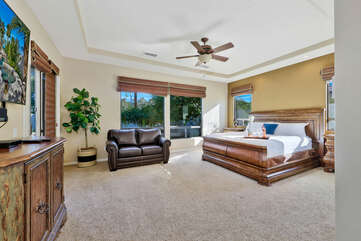 Master Suite 1 is located near the living room and features a Cal King-sized Bed, a Twin-sized Sofa Sleeper, 70-inch Samsung Smart television, and an en suite bathroom.