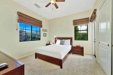 Bedroom 3 is located across from Suite 2 and features a Queen-sized Bed.