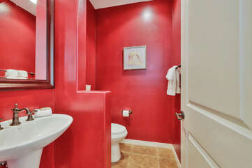 The hallway powder room is located next to the garage.