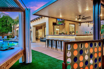 Enjoy a game of connect 4 after you grab a drink at the outdoor bar.