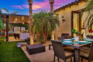 Enjoy your meals on the patio table with seating for six located just outside of Bedroom 6.