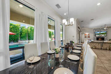 The casual dining room features a dining table with seating for 12.