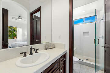 The private, en suite bathroom featuring a tile shower and a vanity sink. Plenty of bath towels will be provided.