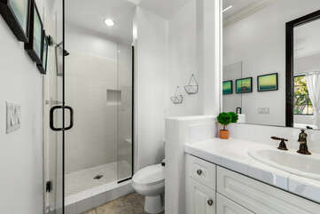 The Casita Suite features a tile shower and a vanity sink.