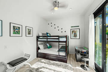 Bedroom 5 is located next to the front door and features a Full Over Full with Full Trundle Bunk Bed, 50-inch TCL with Roku Smart television. A classic 2-player sit down arcade game will be a hit!