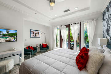 Bedroom 6 features a sitting area and workstation, perfect for a working couple.