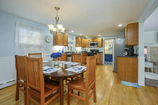 Dining area looking into spacious kitchen and doorway to sunroom-50 Foster Road Hyannis Cape Cod- New England Vacation Rentals