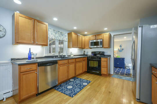 Large kitchen with stainless appliance and gas stove-50 Foster Road Hyannis Cape Cod- New England Vacation Rentals