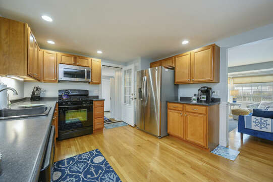 Kitchen view looking to entry to sun room-50 Foster Road Hyannis Cape Cod- New England Vacation Rentals