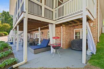 Lower Level patio with Chaise lounge and frisbee golf hole!