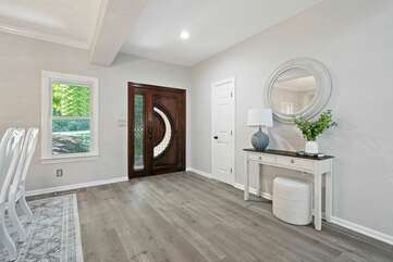 Custom door to enter the foyer with open concept in the living & dining areas.