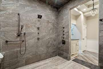 Large shower in master suite with rainfall shower head.