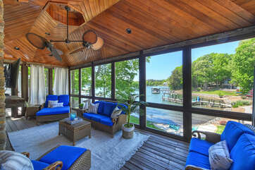 Screened porch, off the main living area, complete with TV, fans, & lake views!!