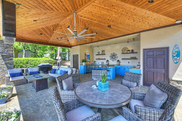 Oasis features an amazing outdoor kitchen and sitting area.