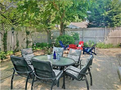 Back yard with outdoor seating and firepit -50 Foster Road Hyannis Cape Cod- New England Vacation Rentals