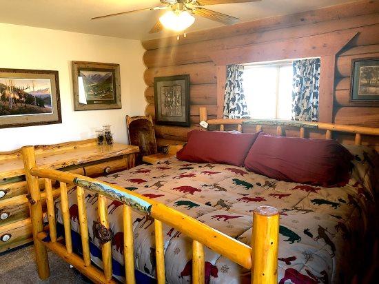 Main Level Master with custom log king bed