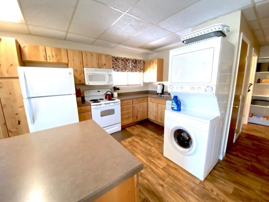 Kitchen has stackable washer and dryer and dishwasher
