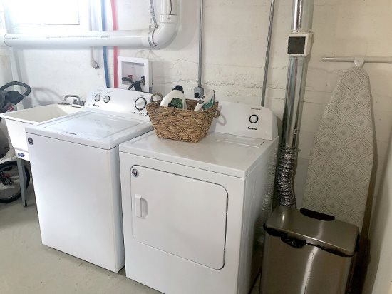 New washer and dryer in basement laundry room