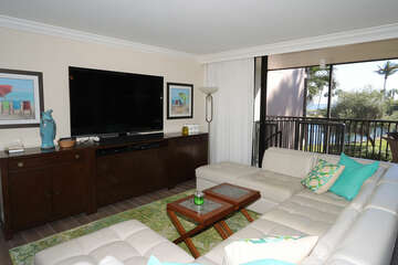 Large leather sectional sofa and TV