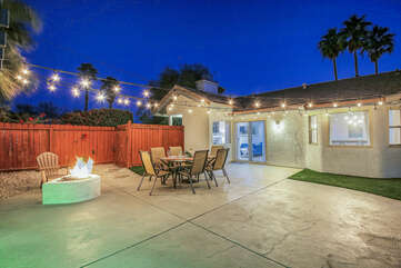Enjoy the roaring fireplace located just between the outdoor bar and patio dinning.