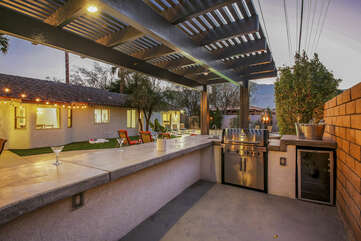Grill up some steaks under the pergola shade structure on the built-in barbecue with a mini-fridge and sink.