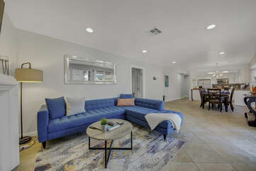 This vacation home opens up to a spacious living room with a family kitchen and dinning area.