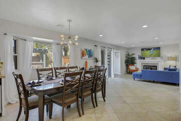 The casual dining area features a dining table with seating for 8.