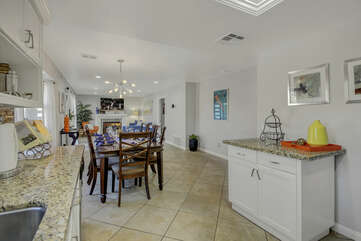 The open kitchen floor plan allows you to mingle and keep an eye on the whole family while making a quick meal.