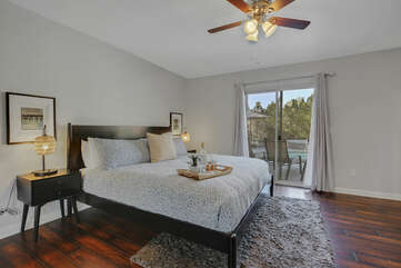 Master Suite 1 is located at the end of the hallway on the right and features a Cal King-sized Bed and a 40-inch JVC HD television.