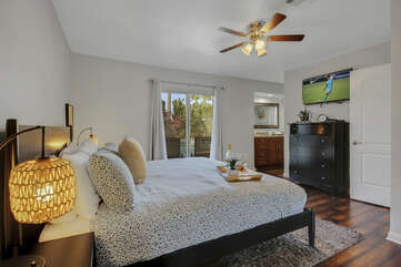 The Master Suite 1 features access to the back patio.