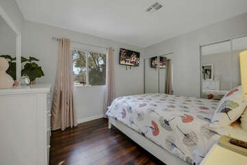 Bedroom 5 is located next to Bedroom 4 and features a Full-sized Bed and a 40-inch Vizio Smart television.