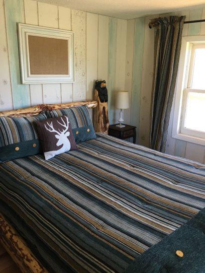 Main floor master bedroom with queen bed